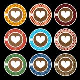 Vector set of love coffee cups with colorful pattern plates. Isolated on black background Royalty Free Stock Images