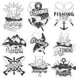 Vector set of monochrome fishing trip emblems. Isolated badges, labels, logos and banners in vintage style with ship Royalty Free Stock Photo