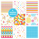 Vector set of nine rainbow seamless patterns - chevron, hearts, Stock Images