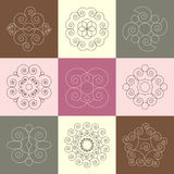 Vector set of nine round snail spiral calligraphic ornaments Royalty Free Stock Photo