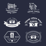 Vector set of old cameras logos. Vintage photo studio, salon signs, labels or badges. Royalty Free Stock Images