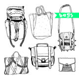 Vector set with original bags. Hand drawn fashion illustration. Actual drawing wear objects: backpack, portfolio, handbag, case Royalty Free Illustration