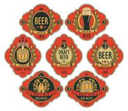Beer labels in figured frames on a red background. Vector set of ornate beer labels in figured frames on a red background with barrel, beer glass, mill, laurel Royalty Free Stock Photos