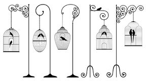 Vector set of outline, antique, bird cages with stands and domestic birds. In black color on white background royalty free illustration