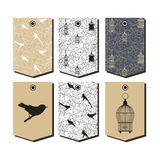Vector set of packaging design templates with birds and vintage birdcages symbols Stock Photos