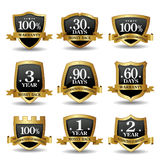 Vector set of 100 percent guarantee golden labels. Vector set of 100 percent guarantee golden shield labels Royalty Free Stock Image