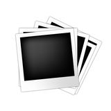 Vector set of polaroid frames. Vector illustration of multiple polaroid frames left upon a table Royalty Free Stock Photos
