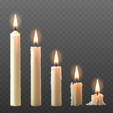 Vector set of realistic white burning candles  on a transparent background. Stock Images