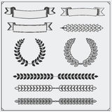 Vector set with ribbons and laurel wreaths. Royalty Free Stock Photos