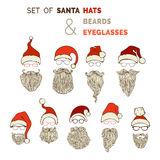 Vector set of Santa hats, moustache, beards and eyeglasses. Royalty Free Stock Images
