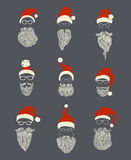 Vector set of Santa hats, moustache and beards. Royalty Free Stock Images