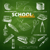 Vector set of school items on a chalkboard Royalty Free Stock Image