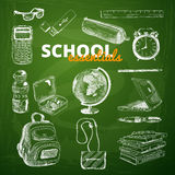Vector set of school items on a chalkboard Stock Images