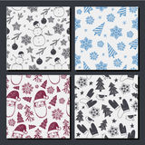 Vector set of seamless hand drawn Christmas, New Year patterns. Royalty Free Stock Photo