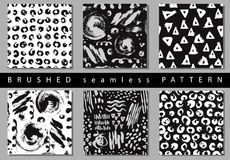 Vector Set of seamless pattern with brush stripes and strokes. Black and white color on background. Hand painted grange. Texture. Ink geometric elements Stock Photography