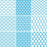 Vector set of seamless pattern scales. Vector set of seamless patterns of fish scales. Collection of endless simple backgrounds in blue and white. For printing Stock Images