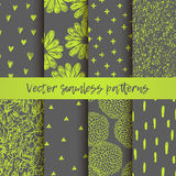 Vector set of seamless vector patterns with triangles, hearts,doodling round flowers, chaotic scribbles, brush stroke. Stock Image
