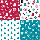 Set of four seamless winter holiday pixel patterns. Vector set of seamless winter holiday backgrounds in red and teal green. Forest theme with reindeer, trees Stock Photography