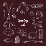 Vector set with sewing equipment. Hand drawn tailor tools. Stock Images