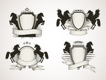 Vector set of shields with old banners and silhouettes rearing h Royalty Free Stock Image