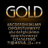 Vector set of shiny gold letters, symbols and numbers on dark background Stock Photography