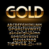 Vector set of shiny golden letters, symbols and numbers Stock Photography