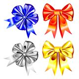 Vector set of shiny ribbon bows. Multi-colored bows of shiny ribbons of silver, gold, red and blue on a white background Royalty Free Stock Photos