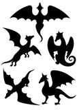 Vector set of silhouettes of dragons stencil. On a white background Royalty Free Stock Images