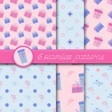 Vector set of six seamless patterns with gift boxes and bows. Stock Image