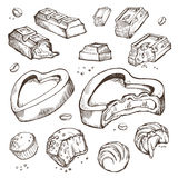 Vector set of sketches bitten chocolates. Sweet rolls, bars, glazed, cocoa beans. Isolated objects on a white background. Vector set of hand-drawn sketches Royalty Free Stock Photo