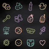 Vector set with sketchy baby icons. Linear illustration of children items on blackboard Royalty Free Stock Images