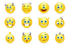 Vector set of smileys style toothy alien monsters Royalty Free Stock Photography