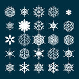Vector set of snowflakes. Winter icons isolated on a dark background. The symbol of the cold weather. A set of 25 different snowflakes on a dark background Royalty Free Stock Image