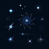 Vector set of sparkle lights stars. Stars with rays, explosion,. Fireworks. dark background Royalty Free Stock Photo