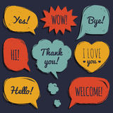 Vector set of speech bubbles in comic style. Hand drawn set of dialog windows with phrases Hello Yes, Bye, Welcome etc. Stock Photos