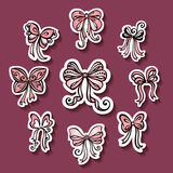 Vector Set of Stickers with Ornamental Holiday Bows Stock Photos