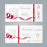Vector set of stylish gift vouchers with red ribbons and paper shopping bag. Royalty Free Stock Images