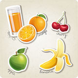 Vector set of stylized food icons. There are an orange juice, some oranges, cherries, an apple and a banana in the set Stock Image