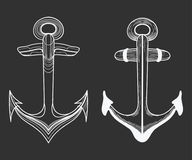 Vector set of stylized ship anchors. Linear Art. Collection of tattoos with an anchor. Stock Photography