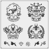 Vector set of tattoo salon labels, badges and design elements. Tattoo studio emblems with professional equipment. Vector set of tattoo salon labels, badges and royalty free illustration