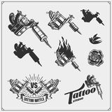 Set of tattoo salon labels, badges and design elements. Tattoo studio emblems with professional equipment. Vector set of tattoo salon labels, badges and design Royalty Free Illustration