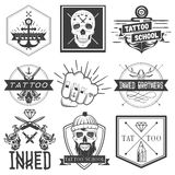 Vector set of tattoo school emblems, logos, banners, labels or badges. Monochrome skulls, anchors, fist in vintage style Royalty Free Stock Photo