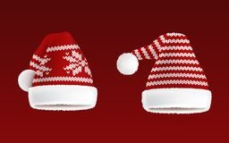 Vector set of two knitted santa hats with pattern. Vector 3d realistic illustration of two knitted santa hats with decorative pattern on them, isolated on red Royalty Free Stock Image