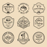 Vector set of vintage bakery logos. Retro emblems collection with sweet biscuit, cupcake etc. Hipster pastry icons. Vector set of vintage bakery logos. Retro Royalty Free Stock Photo