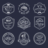 Vector set of vintage bakery logos. Retro emblems collection with sweet biscuit, cupcake etc. Hipster pastry icons. Stock Images