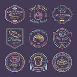 Vector set of vintage bakery logos. Retro emblems collection with sweet biscuit, cupcake etc. Hipster pastry icons. Royalty Free Stock Photography