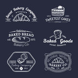 Vector set of vintage bakery logos. Retro emblems collection with sweet biscuit, cupcake etc. Hipster pastry icons. Royalty Free Stock Photo