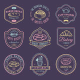 Vector set of vintage bakery logos. Retro emblems collection with sweet cookie. Hipster pastry icons for cafe, shop etc. Vector set of vintage bakery logos Royalty Free Stock Images