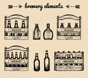 Vector set of vintage brewery elements.Retro collection with beer,lager,ale signs. Sketched boxes or crates with bottles stock illustration