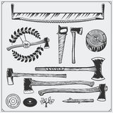 Vector set of vintage carpentry tools. Axes and saws. Stock Photography